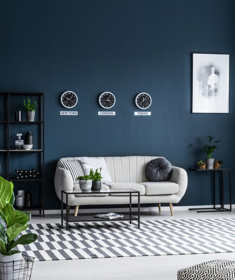 white-sofa-coffee-table-clocks-on-the-grey-wall-an-K3L9PER-1-scaled.jpg